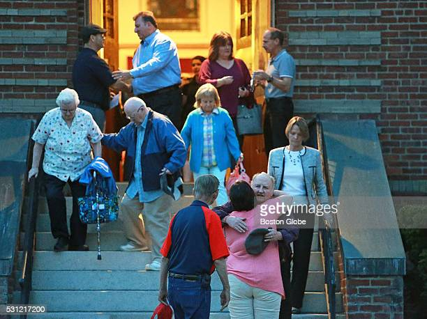 Attendees leave the Holy Family Catholic Church after a vigil for the victims of a stabbing spree the day before in Taunton Mass May 12 2016