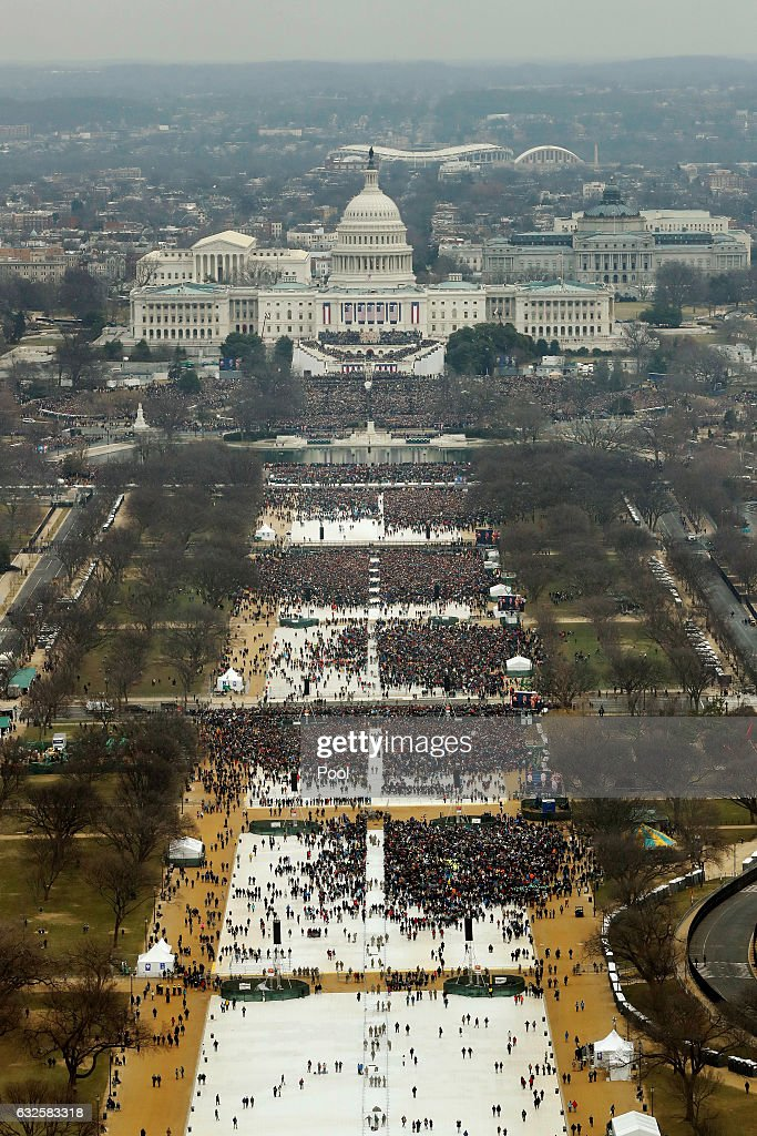 Attendees line the Mall as they watch ceremonies to swear in Donald Trump on Inauguration Day on January 20, 2017 in Washington, DC. Donald J. Trump will become the 45th president of the United States today.