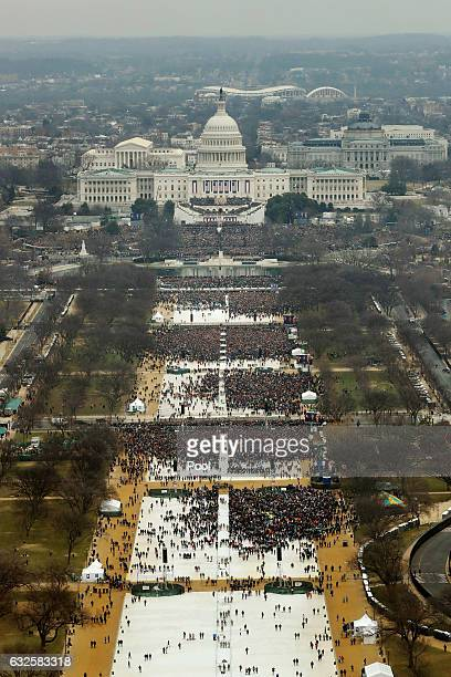 Attendees line the Mall as they watch ceremonies to swear in Donald Trump on Inauguration Day on January 20, 2017 in Washington, DC. Donald J. Trump...