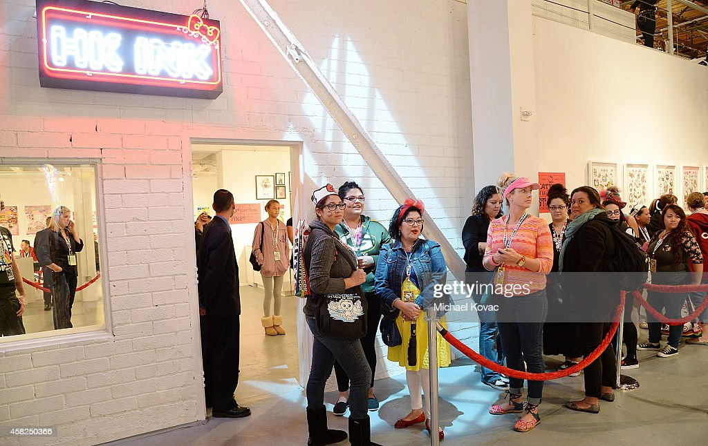 Attendees line up for Hello Kitty tattoos at the HK Ink tattoo parlor at Hello Kitty Con 2014 at The Geffen Contemporary at MOCA on November 1, 2014 in Los Angeles, California.