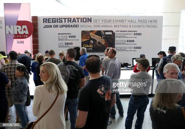 Attendees line up to become registered members of the National Rifle Association during the NRA Annual Meeting Exhibits at the Kay Bailey Hutchison...