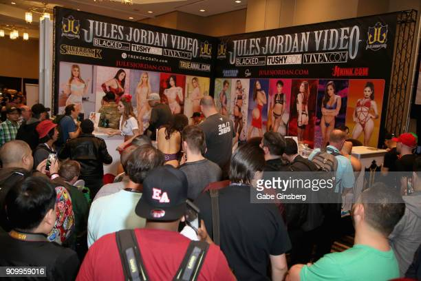 Attendees line up to take photos of adult film actresses at the Jules Jordan Video booth during the 2018 AVN Adult Expo at the Hard Rock Hotel Casino...