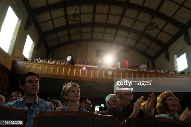 Attendees listen and applaud as Alexandria OcasioCortez a Democratic US Representative candidate from New York not pictured speaks during an event at...