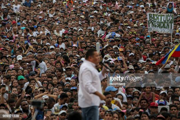 Attendees listen as Evangelical pastor Javier Bertucci presidential candidate for the Esperanza Por El Cambio Party speaks during his closing...