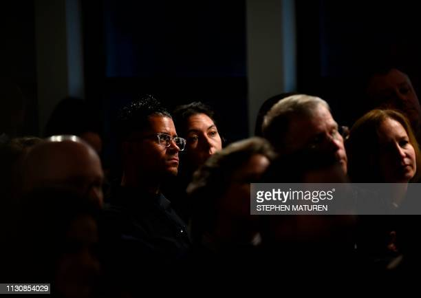 Attendees listen as former Texas Congressman and Democratic party presidential candidate Beto O'Rourke speaks during a podcast taping at Raygun in...