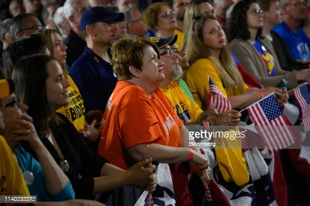 Attendees listen as former US Vice President Joe Biden 2020 Democratic presidential candidate not pictured speaks during a campaign stop in...