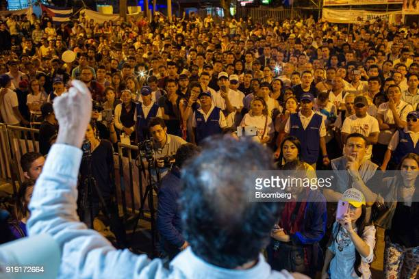 Attendees listen as Gustavo Petro presidential candidate for the Progressivists Movement Party speaks while surrounded by police officers during a...