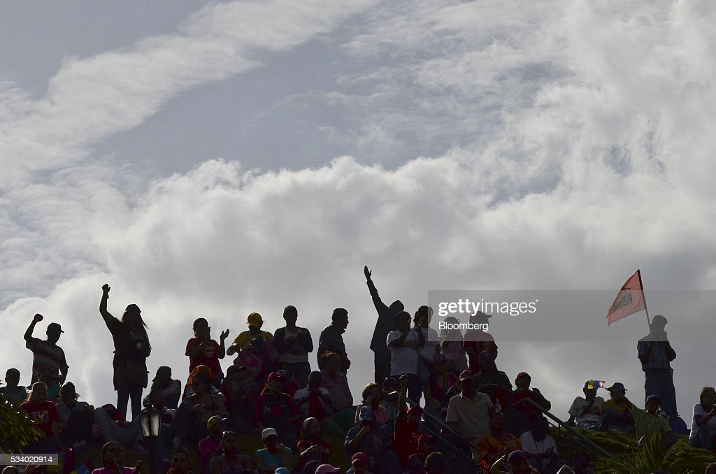 Attendees listen as Nicolas Maduro, Venezuela's president, not pictured, speaks during a rally for women and peace at the Miraflores Palace in Caracas, Venezuela on Tuesday, May 24, 2016. On Tuesday, hundreds of women took to the streets in a show of support for President Maduro and against what they called the violent demonstrations by the opposition. Photographer: Carlos Becerra/Bloomberg via Getty Images