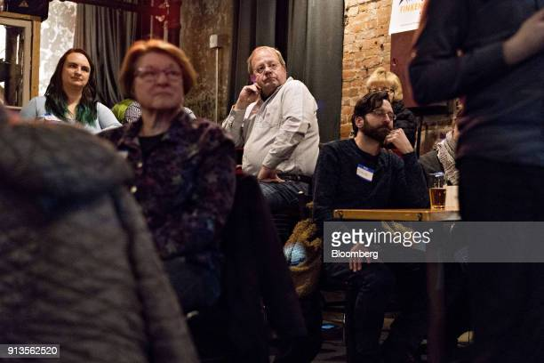 Attendees listen as Representative John Delaney a Democrat from Maryland and 2020 presidential candidate not pictured speaks during a fundraiser for...