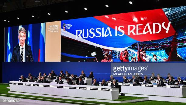 Attendees listen as Russia's World Cup organising committee chief Alexei Sorokin gives a speech during the 68th FIFA Congress at the Expocentre in...