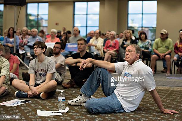 Attendees listen as Senator Bernie Sanders an Independent from Vermont and 2016 US presidential candidate speaks during a town hall meeting in...