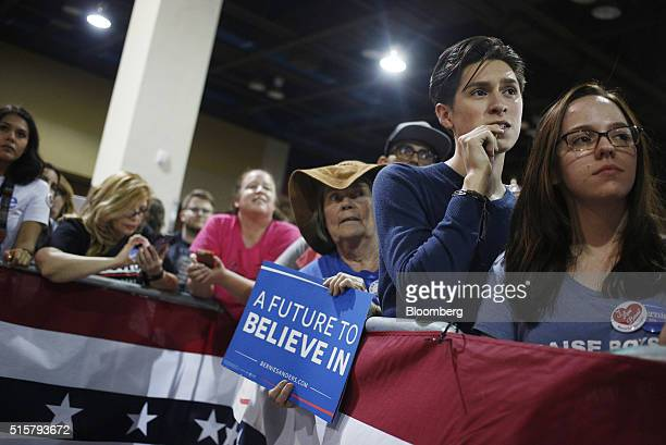 Attendees listen as Senator Bernie Sanders an independent from Vermont and 2016 Democratic presidential candidate not pictured speaks during a...