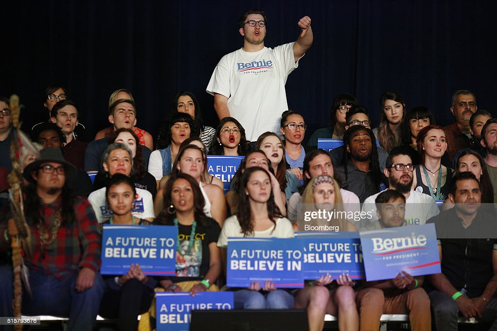 Attendees listen as Senator Bernie Sanders, an independent from Vermont and 2016 Democratic presidential candidate, not pictured, speaks during a campaign event in Phoenix, Arizona, U.S., on Tuesday, March 15, 2016. In Democratic forums, Sanders and Hillary Clinton argue that deportations are ripping apart hard-working undocumented people who are merely trying to make a good life for their families, and that the president must show them mercy, even if it means stretching the limits of the law. Photographer: Luke Sharrett/Bloomberg via Getty Images