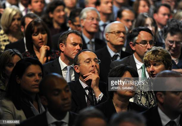 Attendees listen as US President Barack Obama speaks at the British parliament in London on May 25 2011 Obama and his wife Michelle enjoyed a regal...