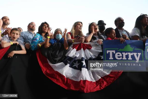 Attendees listen as U.S. President Joe Biden speaks during a campaign event for Terry McAuliffe, Democratic gubernatorial candidate for Virginia, in...