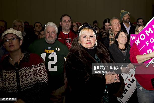 Attendees listen as U.S. President-elect Donald Trump, not pictured, speaks during an event in West Allis, Wisconsin, U.S., on Tuesday, Dec. 13,...