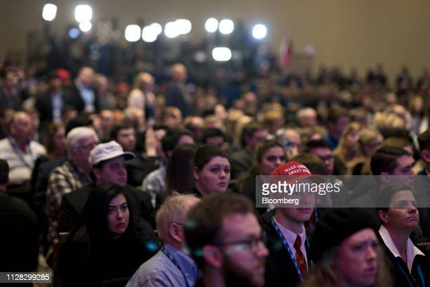 Attendees listen as US Vice President Mike Pence not pictured speaks during the Conservative Political Action Conference in National Harbor Maryland...