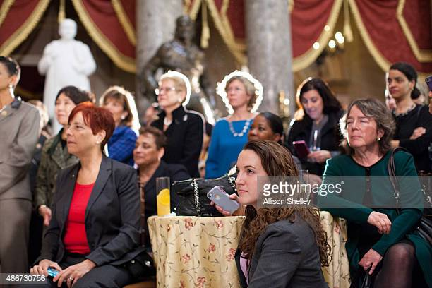 Attendees listen at an annual Women's History Month reception hosted by Democratic House Leader Nancy Pelosi in the US capitol building on Capitol...