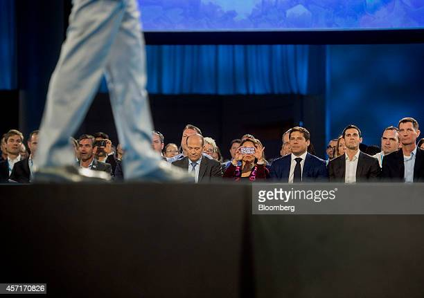 Attendees listen during a keynote address during the DreamForce Conference in San Francisco, California, U.S., on Monday, Oct. 13, 2014....