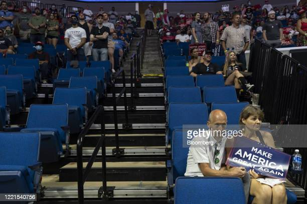 Attendees listen during a rally with U.S. President Donald Trump in Tulsa, Oklahoma, U.S., on Saturday, June 20, 2020. President Trump's first...