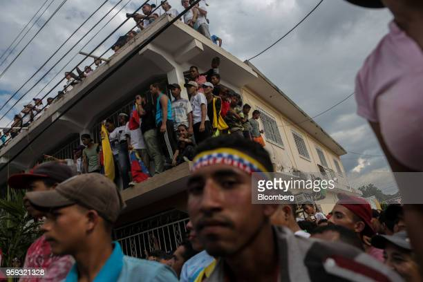 Attendees listen during the closing campaign rally for Evangelical pastor Javier Bertucci presidential candidate for the Esperanza Por El Cambio...