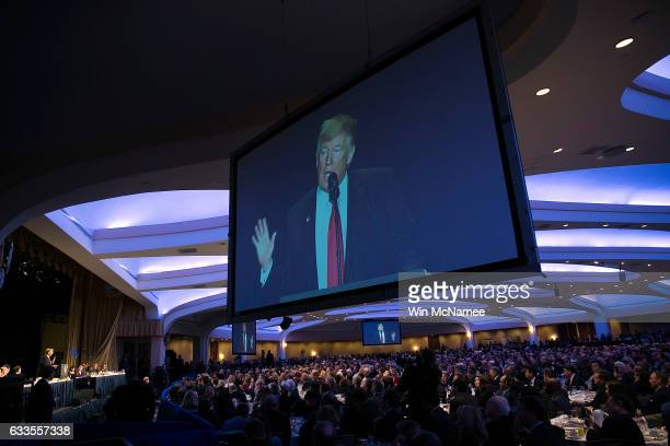 Attendees listen listen as US President Donald Trump delivers remarks at the National Prayer Breakfast February 2 2017 in Washington DC Every US...
