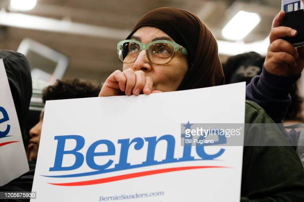 Attendees listen to Democratic presidential candidate Sen. Bernie Sanders speak at a campaign rally at Salina Intermediate School on March 7, 2020 in...