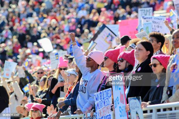 Attendees listen to speakers during the Women's March Power to the Polls voter registration tour launch at Sam Boyd Stadium on January 21 in Las...