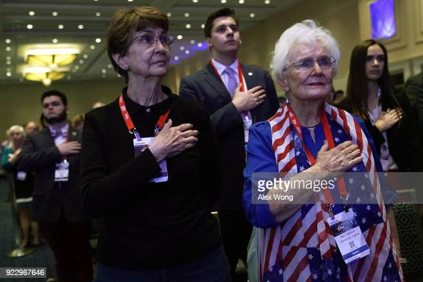 Attendees listen to the national anthem during CPAC 2018 February 22 2018 in National Harbor Maryland The American Conservative Union hosted its...