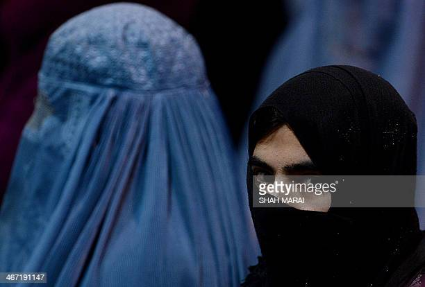 Attendees listen to unseen Afghan presidential candidate and former Islamist warlord Abdul Rasul Sayyaf during an election gathering in Kabul on...