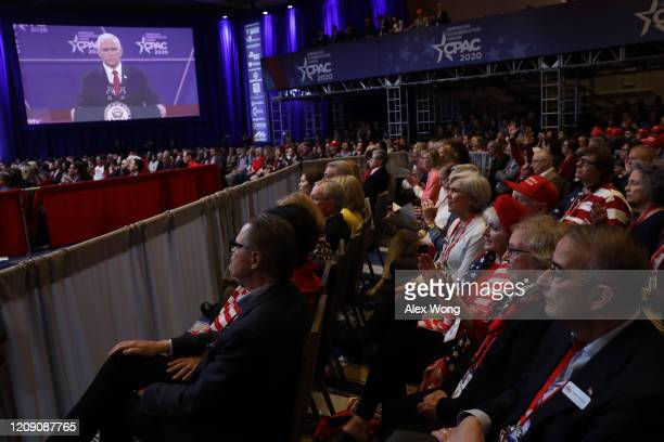 Attendees listen to US Vice President Mike Pence's remarks during the annual Conservative Political Action Conference at Gaylord National Resort...