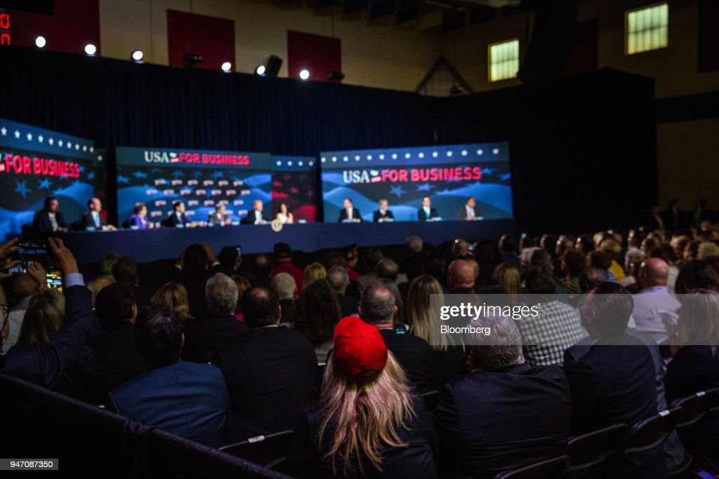 Attendees listen while U.S. President Donald Trump, front center, speaks during roundtable discussion on tax cuts for Florida small businesses in Hialeah, Florida, U.S., on Monday, April 16, 2018. Trump accused China and Russia of devaluing their currencies, breaking from his own Treasury chief's view that no major trading partners are currency manipulators. Photographer: Scott McIntyre/Bloomberg via Getty Images