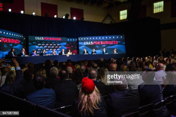 Attendees listen while US President Donald Trump front center speaks during roundtable discussion on tax cuts for Florida small businesses in Hialeah...