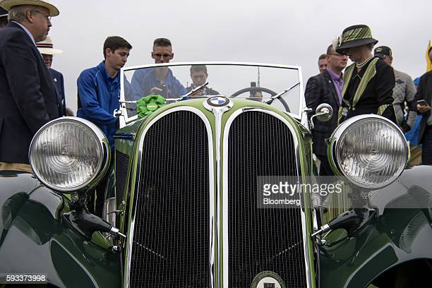 Attendees look at a 1935 BMW 315/1 Roadster motor vehicle, manufactured by Bayerische Motoren Werke AG, during the 2016 Pebble Beach Concours...