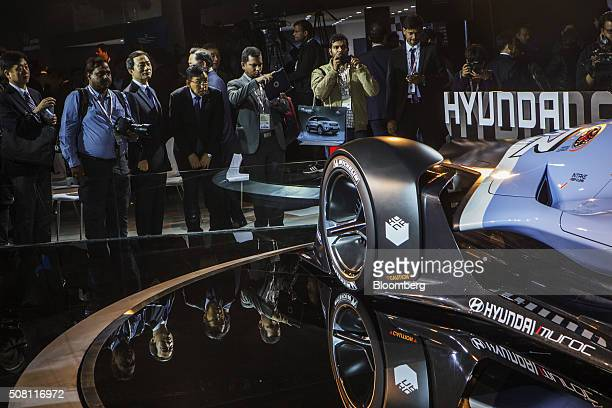 Attendees look at a Hyundai N 50 Gran Turismo concept automobile produced by Hyundai Motor Co at the Auto Expo 2016 in Noida Uttar Pradesh India on...