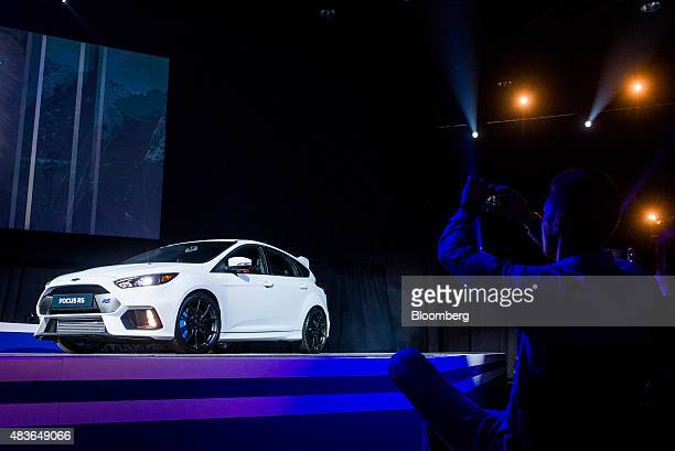 Attendees look at a new Ford Focus RS automobile during a presentation at the Ford Motor Co Go Further event at the Sandton Convention Center in...