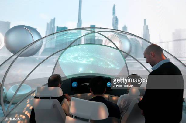 Attendees look at a virtual reality demonstration inside the Hyundai booth during CES 2019 at the Las Vegas Convention Center on January 8 2019 in...