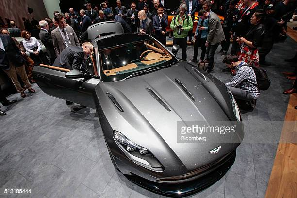 Attendees look at an Aston Martin DB11 automobile produced by Aston Martin on the first day of the 86th Geneva International Motor Show in Geneva...