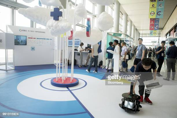 Attendees look at displays during the Baidu Inc Create conference in Beijing China on Wednesday July 4 2018 The company's annual artificial...