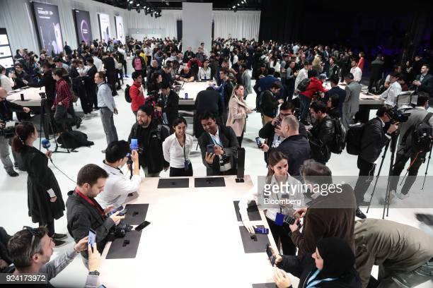 Attendees look at Galaxy S9 smartphones on display during a Samsung Electronics Co 'Unpacked' launch event ahead of the Mobile World Congress in...