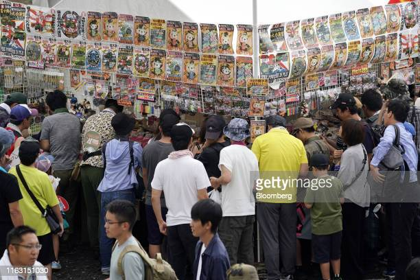 Attendees look at military-theme merchandise prior to a live fire exercise by the Japan Ground Self-Defense Force in the Hataoka district of the East...