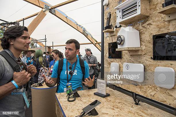 Attendees look at Nest Labs Inc products during the Google I/O Annual Developers Conference in Mountain View California US on Wednesday May 18 2016...