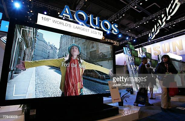 CES attendees look at the Aquos 108 high definition LCD TV the biggest television in the world at the Las Vegas Convention Center during the 2007...