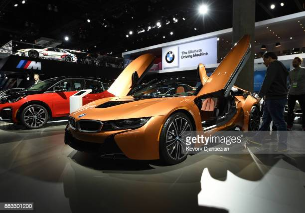 Attendees look at the BMW i8 Roadster during the auto trade show AutoMobility LA at the Los Angeles Convention Center November 30 in Los Angeles...