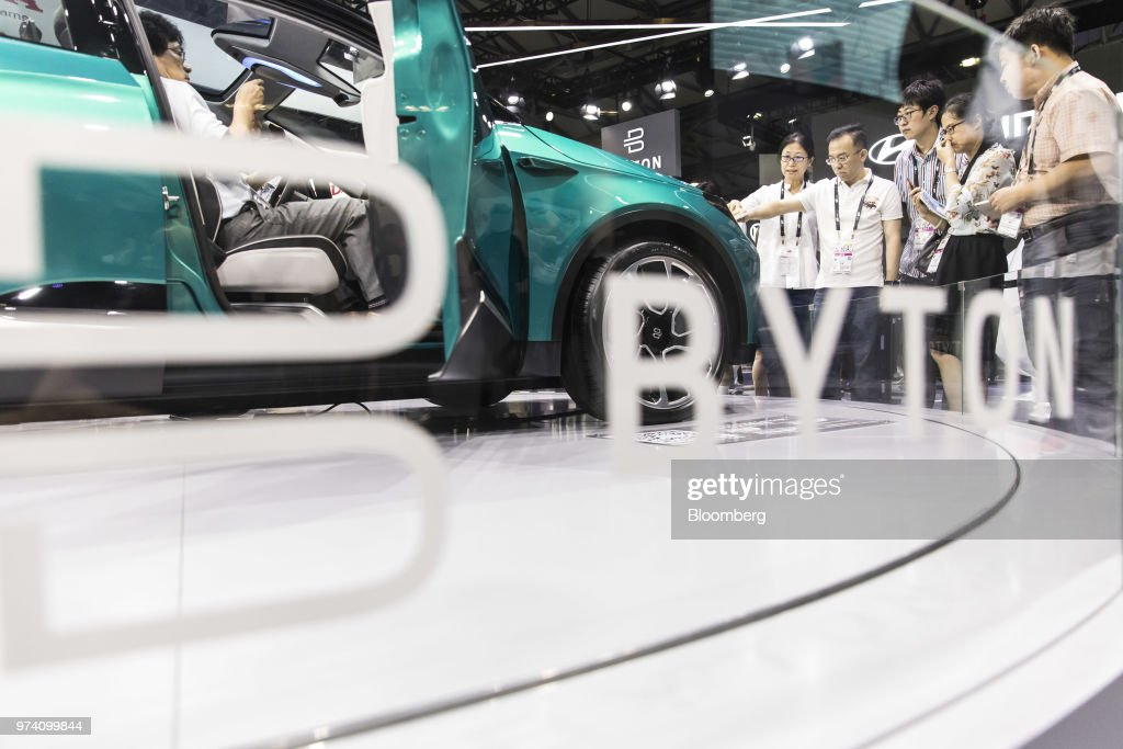 Attendees look at the Byton M-Byte concept vehicle on display at the CES Asia 2018 show in Shanghai, China, on Wednesday, June 13, 2018. The show runs through June 15. Photographer: Qilai Shen/Bloomberg via Getty Images