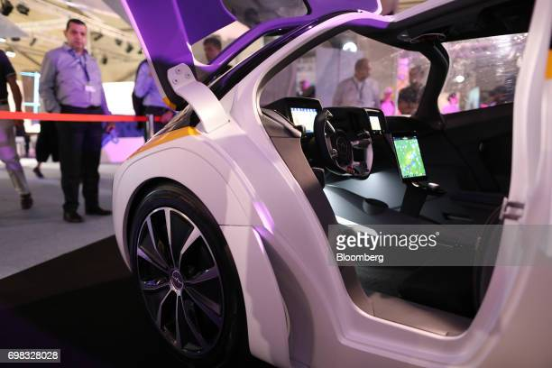 Attendees look at the cockpit of an AeroMobil flying car on display at the 53rd International Paris Air Show at Le Bourget in Paris France on Tuesday...
