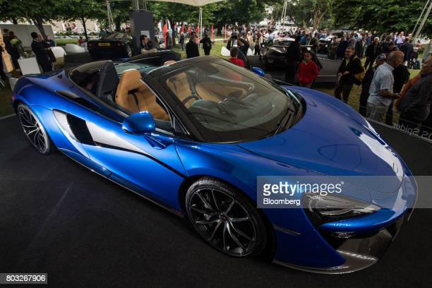 Attendees look at the McLaren 570S Spider during its unveiling at the Goodwood Festival of Speed in Chichester UK on Thursday June 29 2017 McLaren...