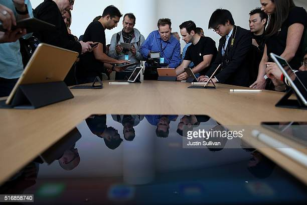 Attendees look at the new 97 iPad Pro during an Apple special event at the Apple headquarters on March 21 2016 in Cupertino California Apple CEO...