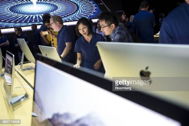 Attendees look at the new Apple Inc iMac Pro desktop computers during the Apple Worldwide Developers Conference in San Jose California US on Monday...