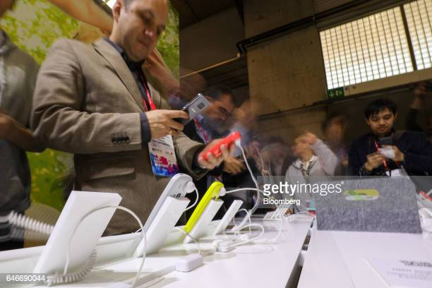 Attendees look at the Nokia 3310 phone on the third day of Mobile World Congress in Barcelona Spain on Wednesday March 1 2017 A theme this year at...